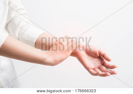 Asian woman wrist pain on white background,office syndrome concept