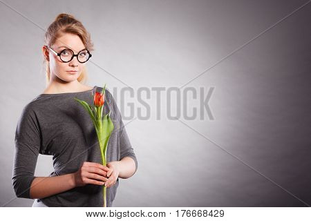 Beauty Woman With Tulip Flower.