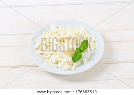 plate of coconut chips on white background