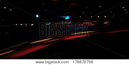 street scene at night tail lights abstract background