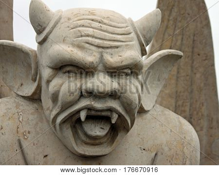 Angry Gargoyle with Horns and Pointy Ears