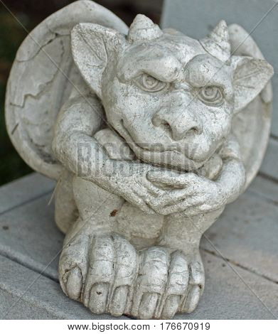 Stone Garden Statue of a Gargoyle Smiling