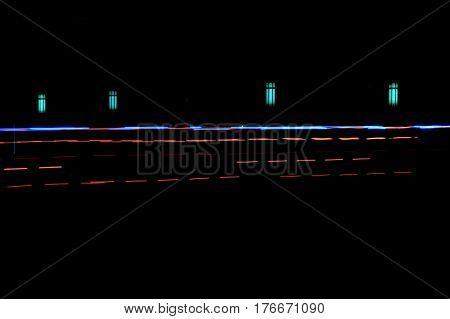 rows of lights in motion at night abstract