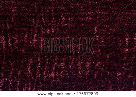 Dark red and gray background of soft fleecy cloth. Texture of textile closeup.