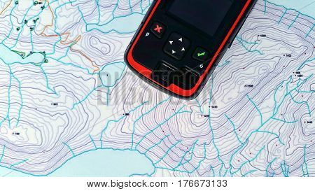 Gps device over a topo map with a red X and a green check mark