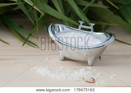 Natural bath salt, organic products poured into a container in the form of a bath
