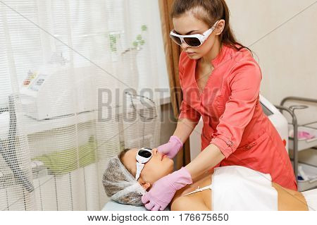 Preparation of laser hair removal on the face. Apparatus cosmetology. Cosmetic procedures. Spa.