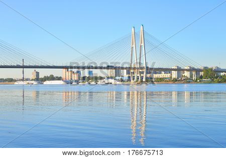 Cable stayed bridge and Neva river on the outskirts of St. Petersburg by day Russia.