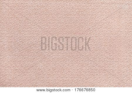 Light beige fluffy background of soft fleecy cloth. Texture of textile closeup.