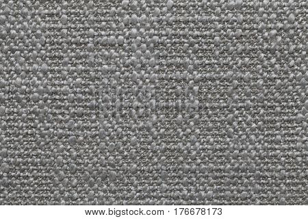 Gray knitted woolen background with a pattern of soft fleecy cloth. Texture of textile closeup.