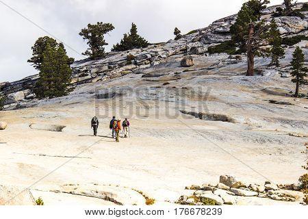 Four Hikers Climb Granite Mountain At Yosemite National Park