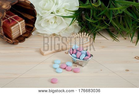 Bath Time color tablets for kids on wood background with spa kit