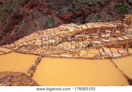 Salinas de Maras - salt evaporation ponds near town of Maras in Peru. These salt pans are in use since Inca times.