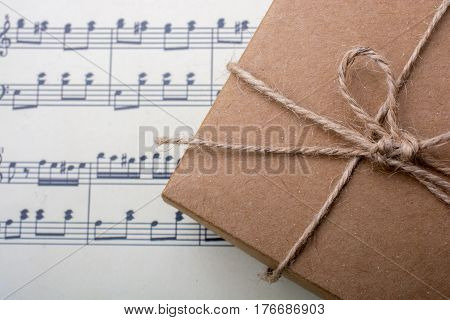Gift box placed on a paper with musical notes