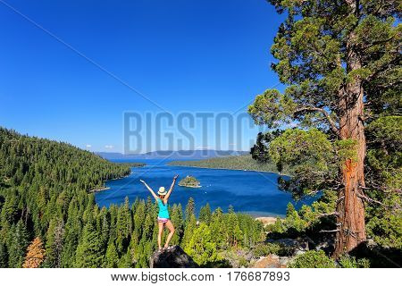 Young Woman Enjoying The View Of Emerald Bay At Lake Tahoe, California, Usa