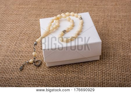 Praying beads of the certain color on a background