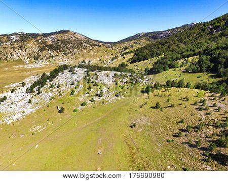 Aerial view of hills and meadows of Dinara mountain, Croatia.