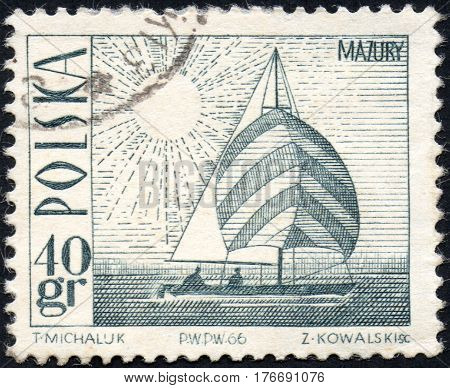 UKRAINE - CIRCA 2017: A stamp printed in Poland shows Amethyst yacht on Masurian Lake circa 1966