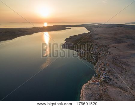 Aerial view of sunset over place Zubovici at island of Pag, Croatia.