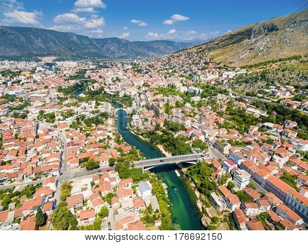 Aerial view of city of Mostar in Bosnia and Herzegovina and it's landmarks (Neretva river, Old bridge, Koski Mehmed Pasha Mosque).