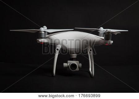 Varna Bulgaria - February 9 2017: drone quadcopter Dji Phantom 4 PRO + in studio on black background