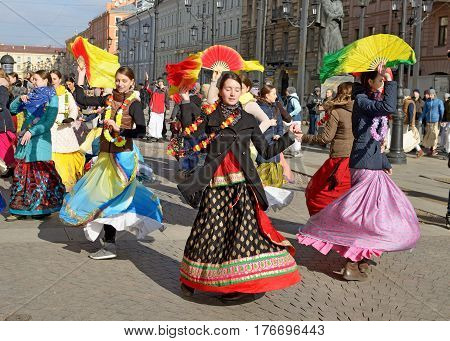 12.03.2017.Russia.Saint-Petersburg.On the street gathered followers of Lord Krishna.Young people are dancingcollecting alms and distributing sweets.