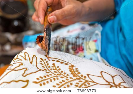 Painting watercolor on the fabric to make Batik. Batik-making is part of Indonesian culture