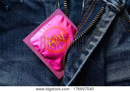 Pink condom on jeans zipper -Stop hiv or aids concept