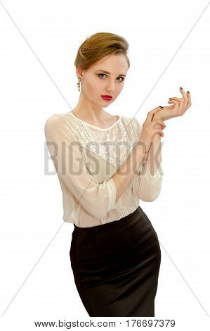 An image of a beautiful young girl in a white blouse and black skirt