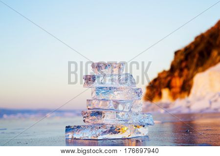 Pyramid of transparent pieces of ice on the surface of the lake Baikal