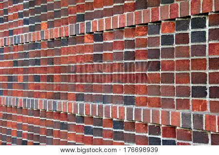 Horizontal image of red and gray brick wall background