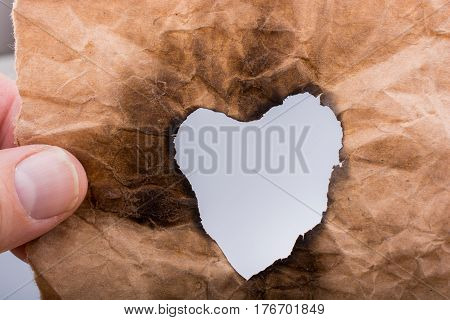 Heart Shaped Burnt Out Of A Paper