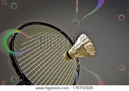 Abstract badminton play -Racket and shuttlecock high up.