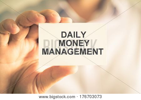 Businessman Holding Daily Money Management Message Card