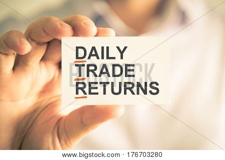Businessman Holding Card With Dtr Daily Trade Returns Acronym Text