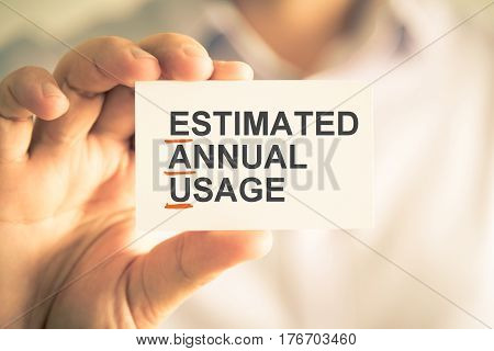 Businessman Holding Card With Eau Estimated Annual Usage Acronym Text
