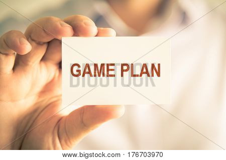 Businessman Holding Game Plan Message Card