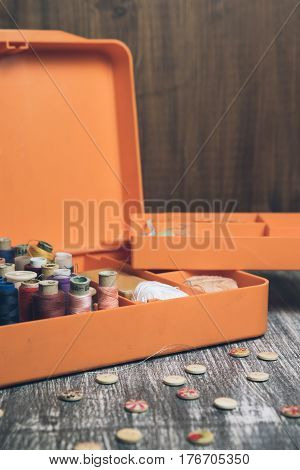 Sewing Tools And Accessories On Orange Casket