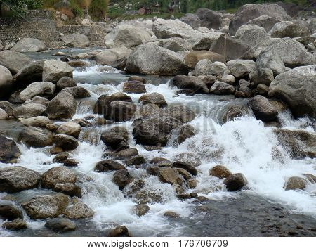 Rocks in force of white water rapids in river