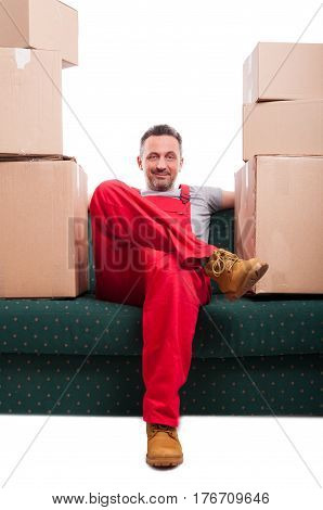 Mover Man Sitting On Couch With Cardboard Boxes Around
