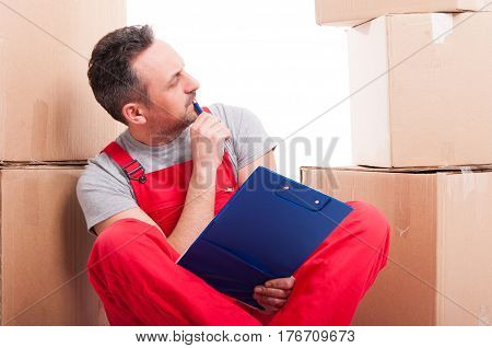 Mover Guy Sitting Holding Clipboard And Thinking