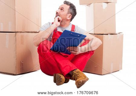 Mover Guy Sitting On The Floor Holding Clipboard