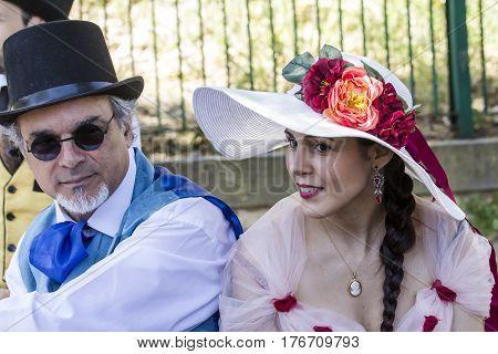 CAGLIARI, ITALY - May 29, 2016: Sunday at La Grande Jatte VIII Ed. At the Public Gardens - portrait of a couple in Victorian costumes - Sardinia
