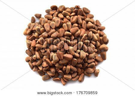 Unpeeled korean (siberian) cedar pine nuts isolated on white background