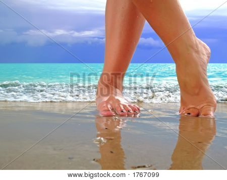 Female Legs On Beach