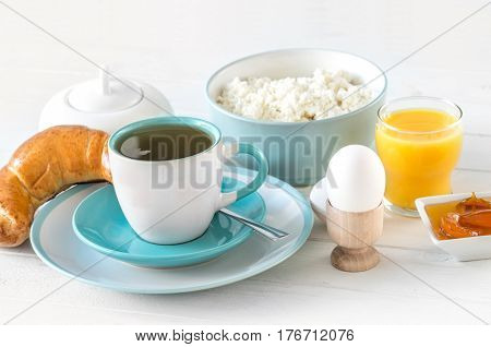 Delicious brunch with cheese and eggs, coffee and homemade bakery, fitness style