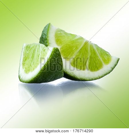 Close-up image of lime slices studio isolated on abstract greenish background