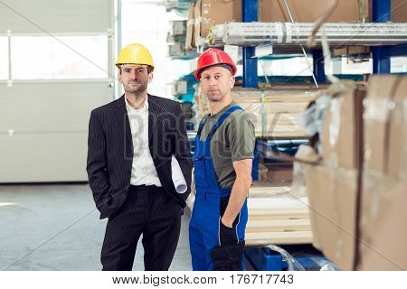 Boss And Worker In Stockroom