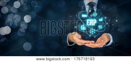 Enterprise resource planning ERP concept. Businessman offer ERP business management software for collect, store, manage and interpret business data about customers, HR, production, logistics, financials and marketing.