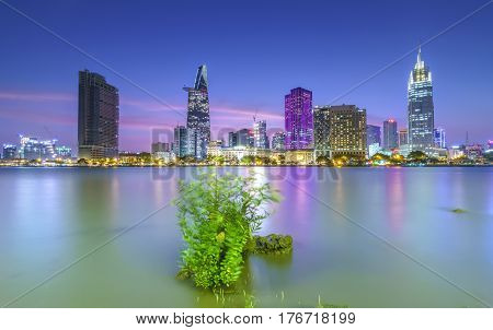 Ho Chi Minh City, Vietnam - March 9th, 2017: Beauty skyscrapers along river light smooth down urban development in Ho Chi Minh City, Vietnam